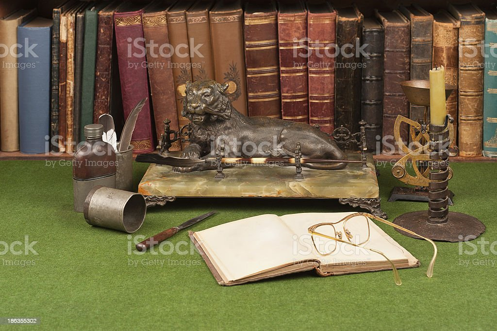 Antique leather books, inkwell and reading glasses royalty-free stock photo
