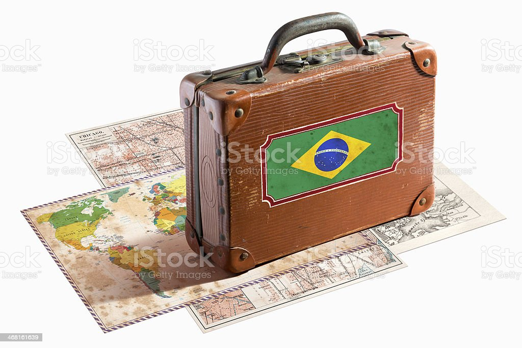 Antique leather suitcase with Brazil flag on maps stock photo