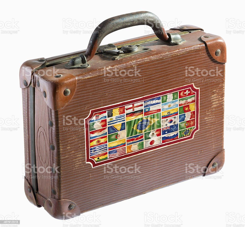 Antique leather suitcase with different flags stock photo