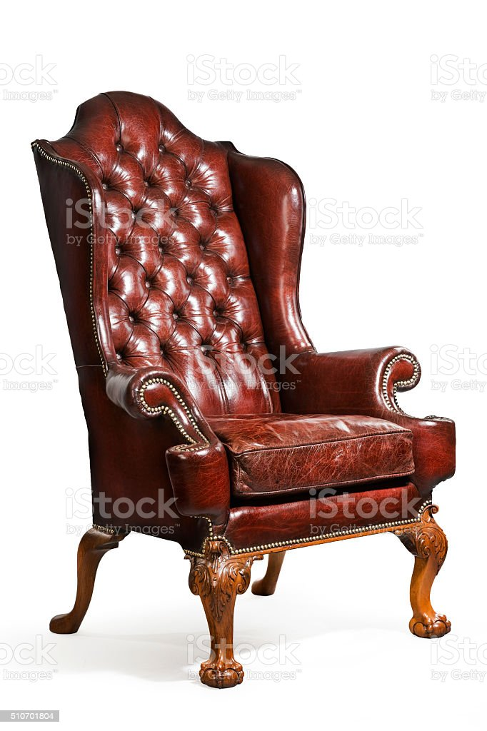antique leather wing chair carved legs isolated stock photo