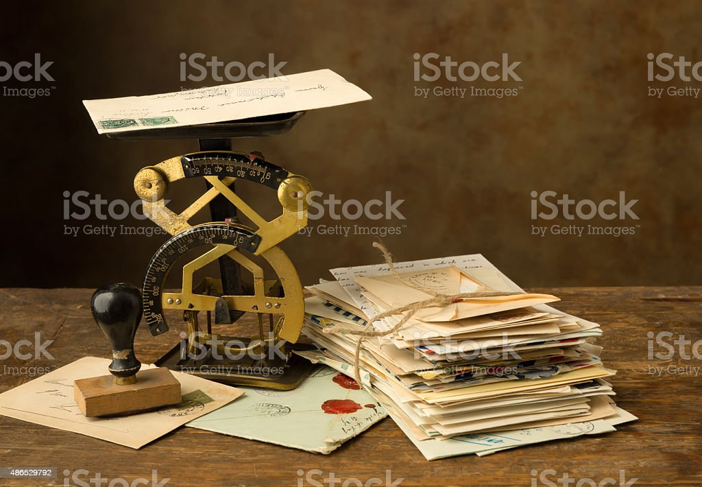 Antique letter scale and old letters stock photo