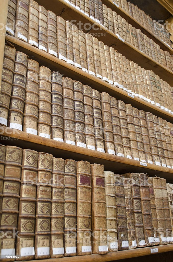 Antique library shelves with old books royalty-free stock photo