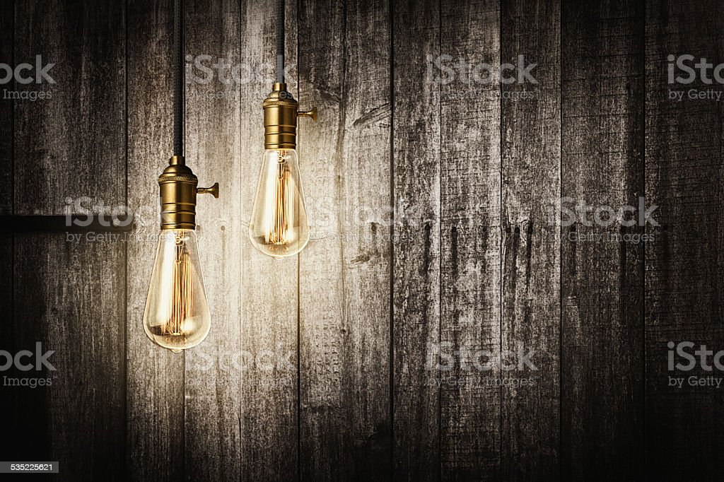Antique light bulbs on wooden background stock photo