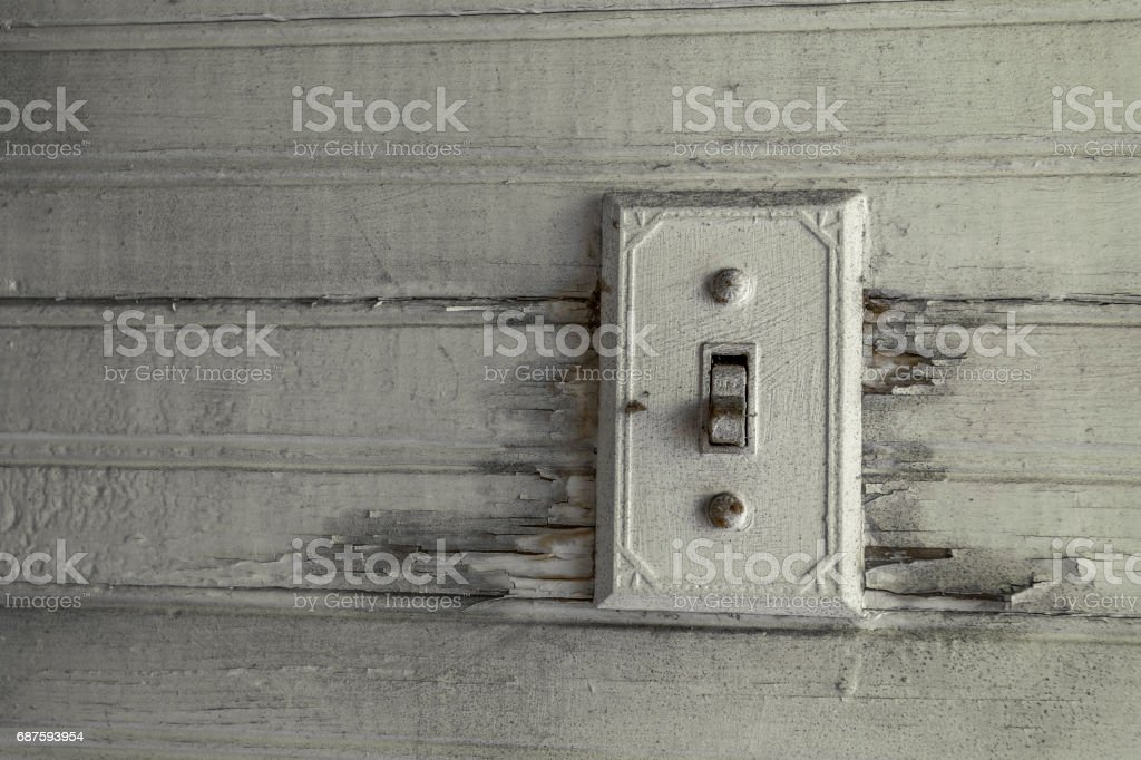 Antique light switch in an abandoned house stock photo