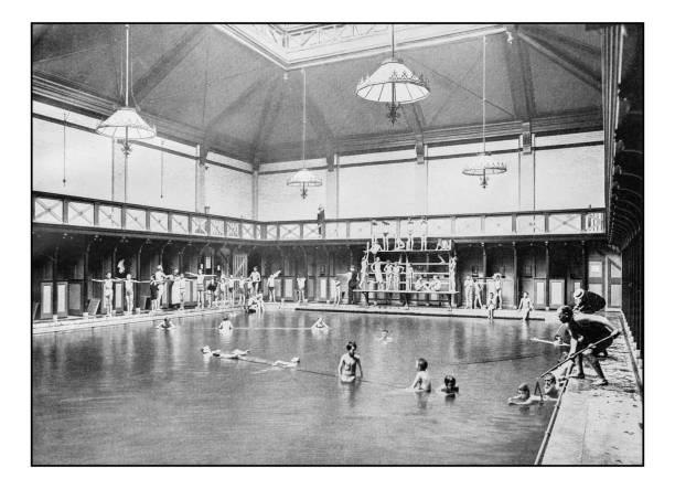 antique london's photographs: swimming lesson in kensington public baths - archival stock photos and pictures