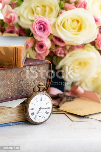 882302538 istock photo antique mail and clock 958457448