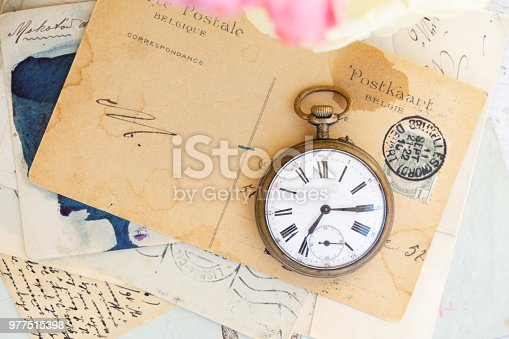 882302538 istock photo antique mail and clock 977515398