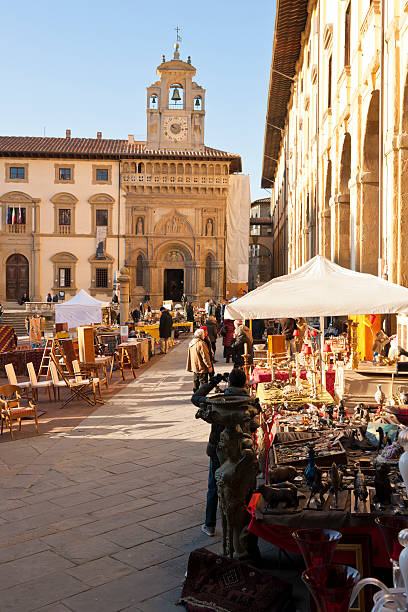 Antique Market of Arezzo in Tuscany Arezzo, Italy - December 31, 2011: Tourists and locals at the monthly antique fair held in the main square of Arezzo. piazza grande stock pictures, royalty-free photos & images