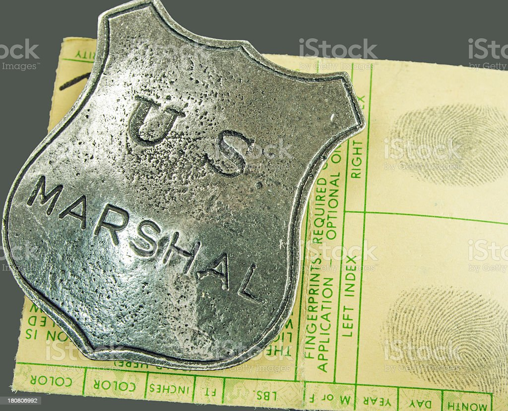 Antique Marshal Badge and Fingerprints royalty-free stock photo