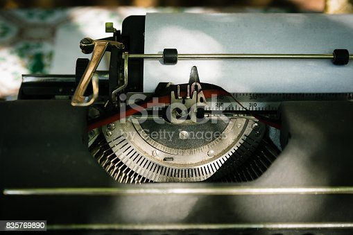 istock Antique mechanical typewritter outdoors in shadows 835769890
