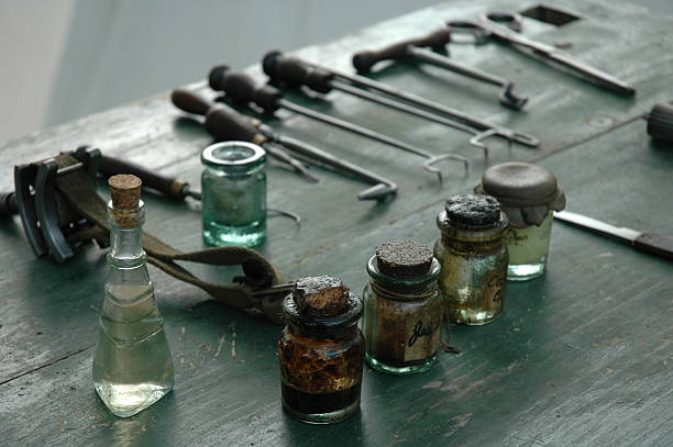 Antique Medical and Dental Equipment Antique medical equipment and medicine bottles evoke thoughts of horror. war effort stock pictures, royalty-free photos & images