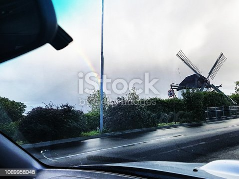 The windmill, known as Mostert's Mill on de Waal Drive (M3) at Mowbray, Cape Town is the only working windmill in Africa, south of the Sahara. Seen through the windshield of a car on a rain day.