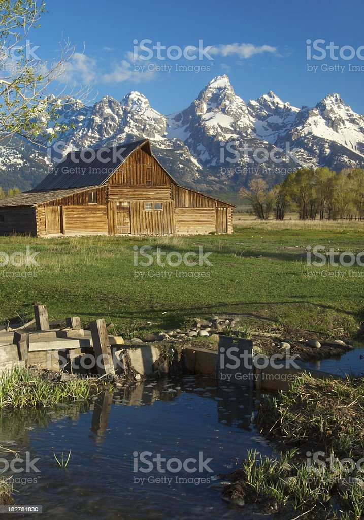 Antique Moulton Barn, Snowy Tetons, and Reflecting Pond royalty-free stock photo