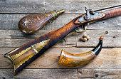 Antique Mountain man's 50 cal rifle and gunpowder flasks made around 1840.