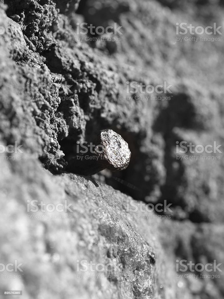 Antique Nail in Granite royalty-free stock photo