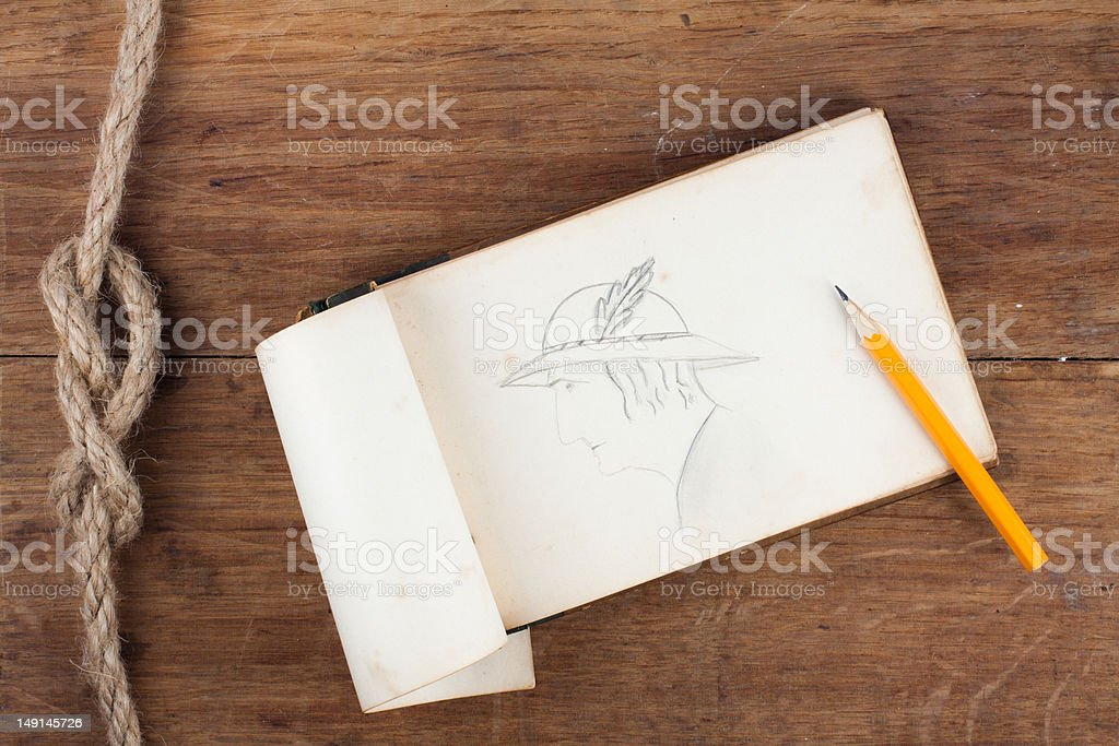 Antique Notebook (1940th) and pencil on wooden background royalty-free stock photo