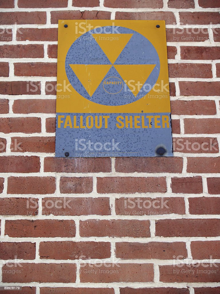 Antique Nuclear Fallout Shelter Sign on Brick Wall stock photo