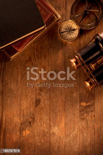 istock Antique objects on a Wooden Desk 185297819