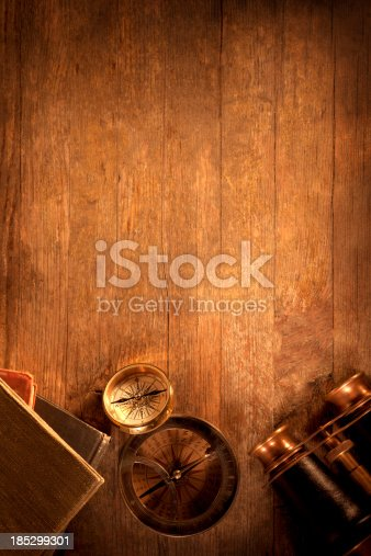 istock Antique Objects on a Wooden Desk 185299301