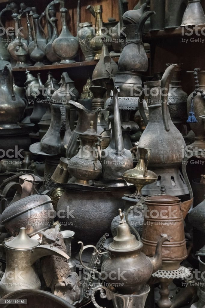Antique oil lamps and water pitchers стоковое фото
