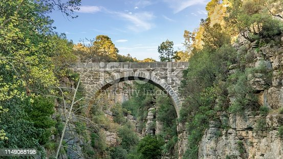 Antalya, Turkey - March 2019: Antique Oluk Bridge across Kopru Irmagi creek in Koprulu Kanyon national park in Antalya Turkey.