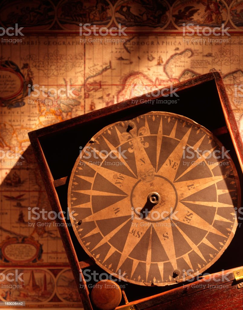 Antique paper compass on old map background stock photo