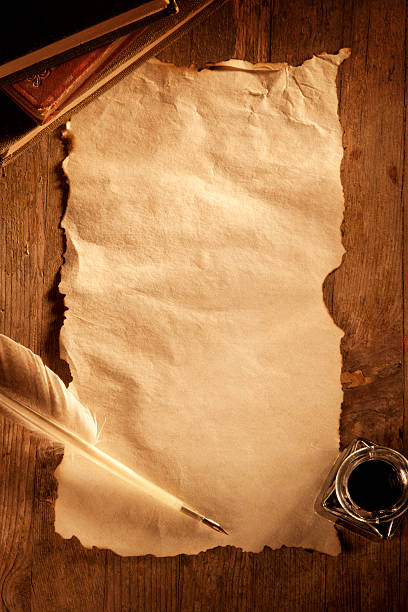 antique paper on a wooden desk - scroll stock photos and pictures