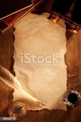 istock Antique Paper on a Wooden Desk 185305715