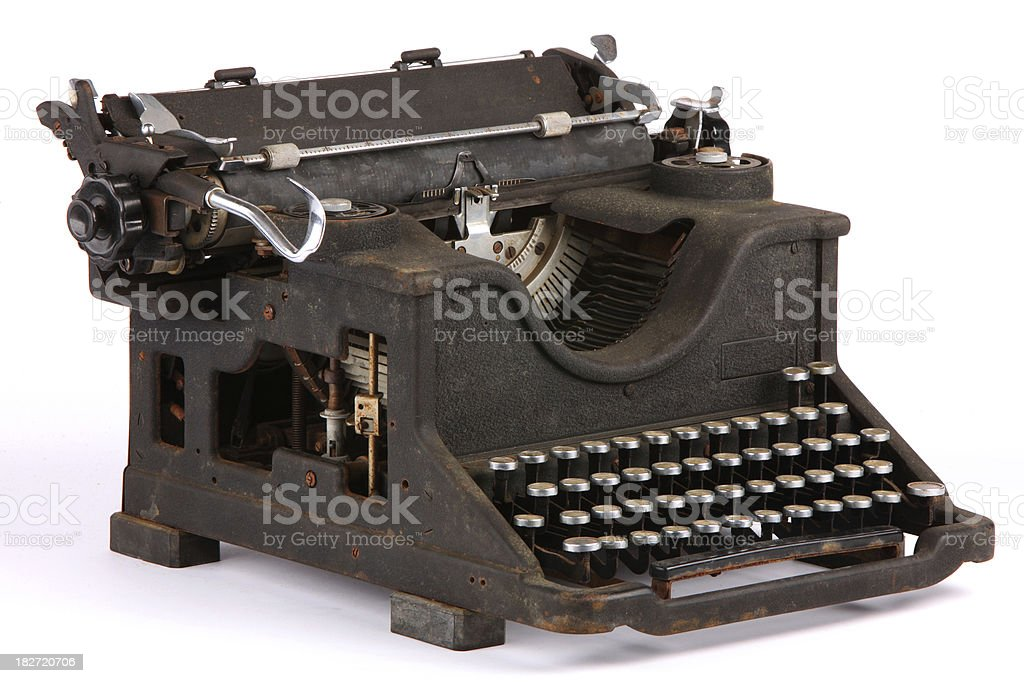 Antique person corrode typewriter against white background royalty-free stock photo