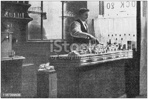 Antique photo: Barman serving drinks