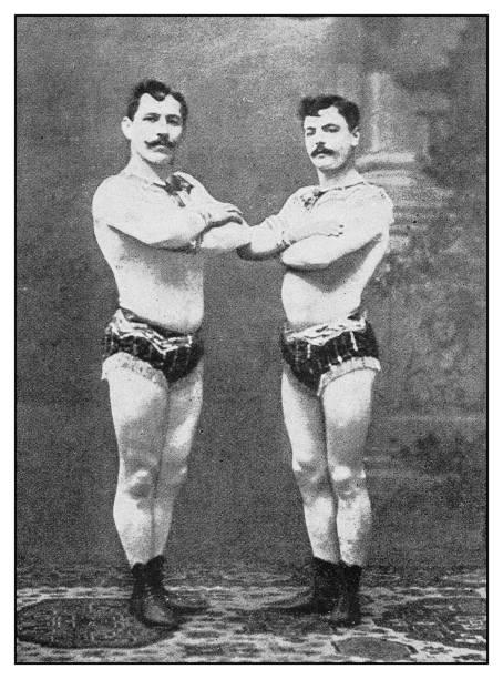 Antique photo: Circus performers acrobats stock photo