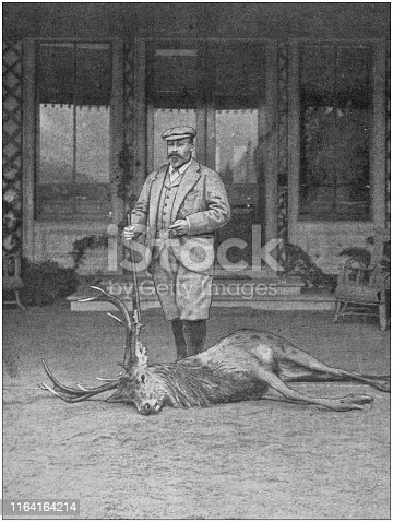 Antique photo: Hunter with dead deer