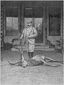 Antique photo: Hunter with dead deer