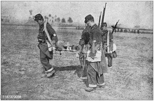 Antique photo: Injured soldier assistance