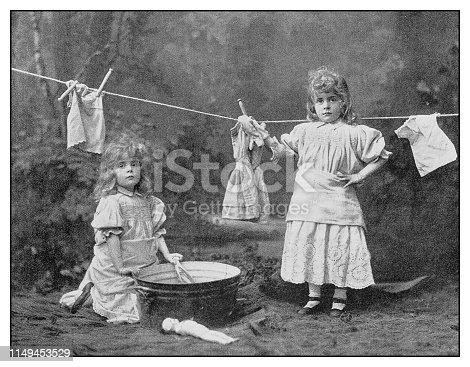 Antique photo: Little girls laundry
