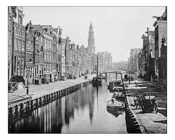 antique photograph of a canal in amsterdam (netherlands)-19th century - westerkerk stockfoto's en -beelden