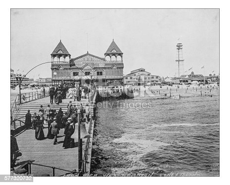 Antique photograph of West Brighton Beach resort (Coney Island,Brooklyn,New York City, USA) in a picture dating back to the late 19th century depicting people walking along the pier and toward the Beach pavilion.