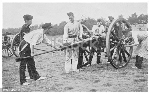 istock Antique photograph of British Navy and Army: Gunners at work 1250045265