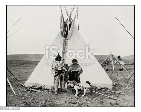 Antique photograph of Bull's Head Indian, woman and dog