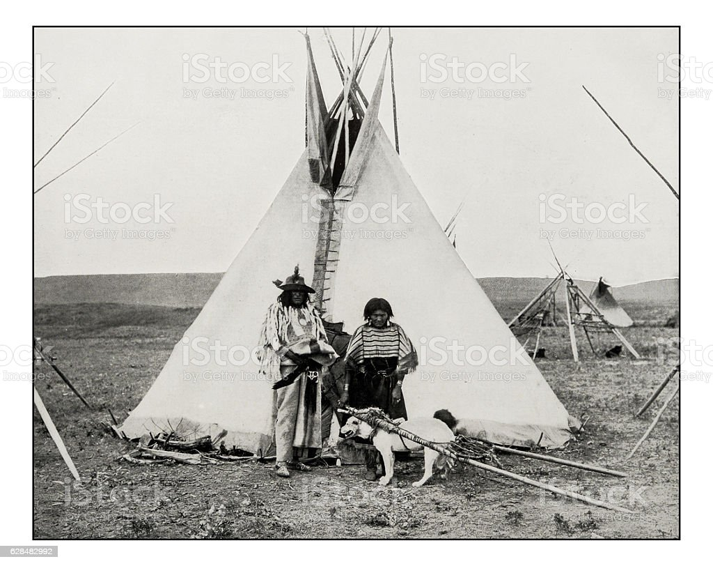 Antique photograph of Bull's Head Indian, woman and dog stock photo