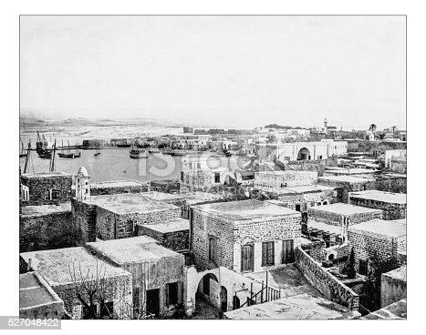 Antique photograph of view of the ancient city of Tyre (Lebanon) as it was in the late 19th century with its old traditional houses and the harbor. This very  ancient city (Phoenician, Greek, Roman, Ottoman) is listed as a UNESCO World Heritage Site.