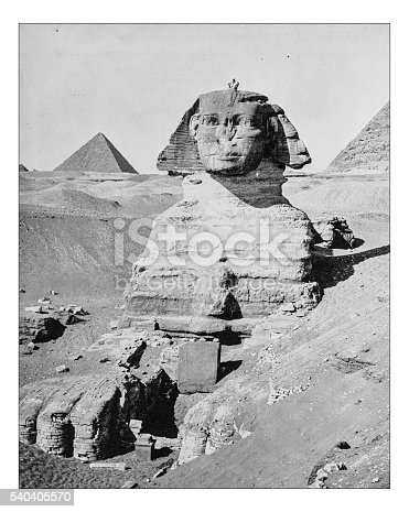 Antique photograph of the Great Sphinx of Giza (Egypt) in a frontal picture taken during the 19th century with the pyramids (Pyramid of Khafre and Great Pyramid of Giza) in the background on the Giza Plateau.