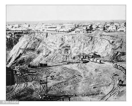 Antique photograph of the Kimberley Diamond mines (Kimberley, Northern Cape Province, South Africa) towards the end of 19th century.On the foreground the excavation site (what will become the so-called