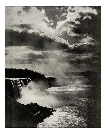 Antique photograph of Niagara Falls by moonlight