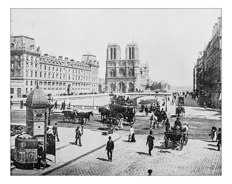 Antique photograph of View of western (?) facade of the medieval Cathedral of Notre-Dame de Paris (France) seen from place Jean-Paul-II as the area appeared towards the end of the 19th century.