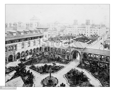 Antique photograph of panoramic view from above of the Ponce de León Hotel (St. Augustine, Florida, USA) during the late 19th century, with the main buildings and gardens. The late 19th century building is an exclusive hotel in Spanish Renaissance style (a mix of Spanish and Moorish design), now part of Flagler College.