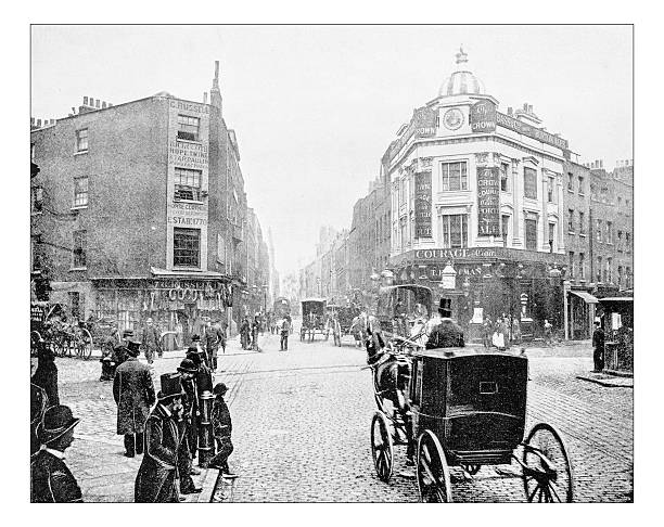 Antique photograph of Seven Dials junction in London (19th century) Antique photograph of Seven Dials junction in London as it was in the late 19th century. It is a small circular square, a road junction of seven streets in Covent Garden in the West End of London. In the picture the square, busy with people and carriages, with its buildings with pubs and shops of a district tha was quite poor (now it's a fashionable shopping district). 19th century stock pictures, royalty-free photos & images