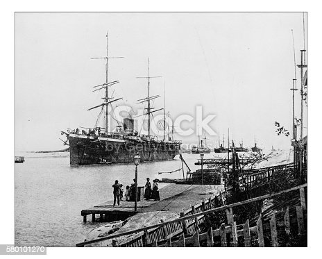 Antique photograph of a line of ships passing through the Suez Canal during the 19th century, shortly after the artificial waterway connecting the Mediterranean Sea to the Red Sea through the Isthmus of Suez was created in Egypt.