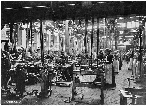 istock Antique photograph of the British Empire: Women working in cycle factory 1204588122