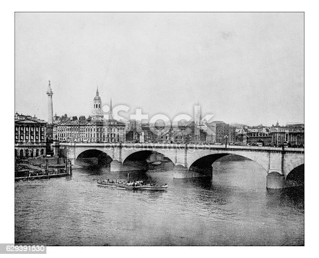 Antique photograph of the old London Bridge on the River Thames (London, England) depicted in a late 19th century picture, before the XX century reconstruction of the historical Victorian age bridge.